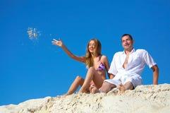 Couple sitting on beach royalty free stock image