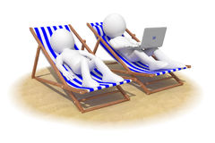 Couple sitting in beach chairs Stock Image