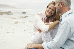 Couple Sitting On Beach Stock Photography