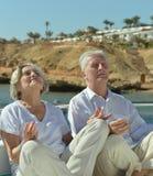 Couple sitting on beach Stock Photo