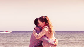 Couple sitting on beach relaxing and hugging Royalty Free Stock Photography