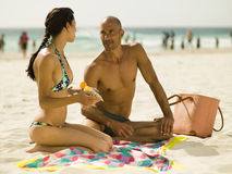 Couple sitting on the beach. Royalty Free Stock Photography