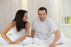 Couple sitting in bed Stock Photos