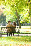 Couple sitting on a bench Royalty Free Stock Image