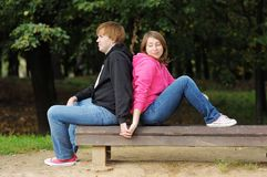 Couple sitting on the bench Stock Photos