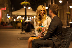 Couple sitting on a bench Stock Photos