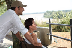 Couple sitting on a bench Royalty Free Stock Images