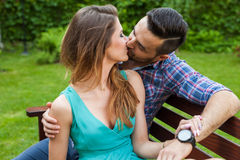 Couple sitting on the bench, they are in love. Royalty Free Stock Photo