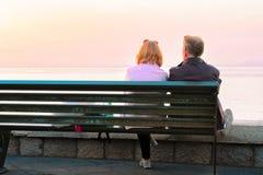Couple sitting on bench in Marina Grande in Sorrento. Couple sitting on the bench in Marina Grande in Sorrento, Tyrrhenian sea, Amalfi coast, Italy Royalty Free Stock Photos