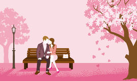Couple sitting on a Bench Pink color Stock Photo