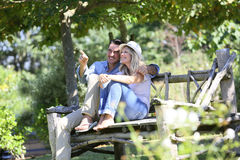 Couple sitting on a bench relaxing Royalty Free Stock Images