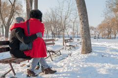Couple Sitting On Bench In Winter Royalty Free Stock Image