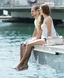 Couple sitting on berth Royalty Free Stock Photography