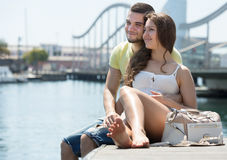 Couple sitting on berth Stock Images