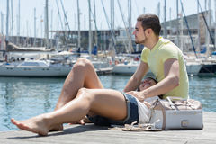 Couple sitting on berth Royalty Free Stock Photos