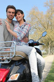 Couple sitting on a bike Royalty Free Stock Photo