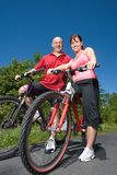 Couple Sitting on Bikes - vertical Royalty Free Stock Image
