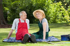 Couple sitting on a blanket in the garden Stock Photo