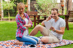 Couple sitting on a blanket at summer green park Royalty Free Stock Photography