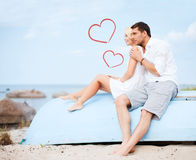 Couple sitting on boat at sea side Royalty Free Stock Images