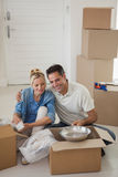 Couple sitting with boxes in new house Stock Photos