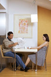 Couple sitting at breakfast table Stock Photo