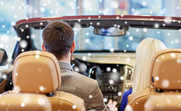 Couple sitting in cabrio car at auto show Royalty Free Stock Image