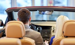 Couple sitting in cabriolet car at auto show Royalty Free Stock Photo