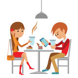 Couple sitting in the cafe, flirting and talking about something.  Stock Photo