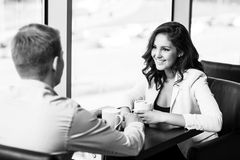 Couple sitting at a cafe Stock Photo