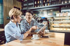 Couple sitting in cafe stock images