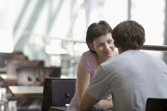Couple Sitting In Cafe Stock Photos