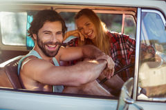 Couple sitting in a campervan. Portrait of couple sitting in a campervan on a sunny day royalty free stock photography
