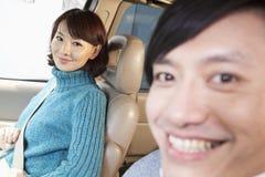Couple sitting in car, Beijing Stock Photo