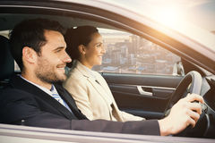 Couple sitting in a car and smiling Stock Photography