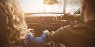 Couple sitting in car during test drive. Rear view of couple sitting in car during test drive Royalty Free Stock Image