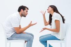 Couple sitting on chairs arguing Stock Photo