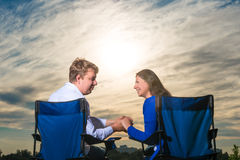 Couple sitting in chairs at dawn Stock Photography