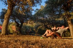Couple sitting in chairs and enjoy the sunet stock photography