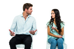 Couple sitting on chairs having argument Stock Image