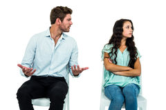 Couple sitting on chairs having argument Royalty Free Stock Photography