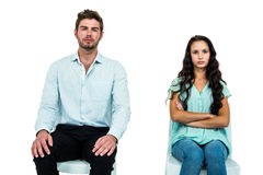 Couple sitting on chairs not talking after argument Stock Photography