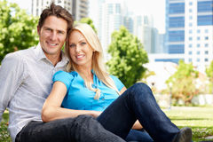 Couple sitting in city park Royalty Free Stock Image