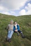 Couple Sitting On Coastal Landscape Royalty Free Stock Photo