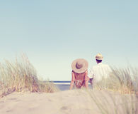 Couple Sitting Comfortable Beach Grass Holiday Concept Royalty Free Stock Photography
