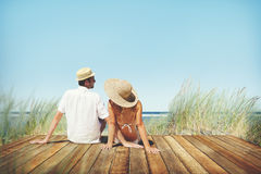 Couple Sitting Comfortable Beach Grass Holiday Concept.  Royalty Free Stock Photos