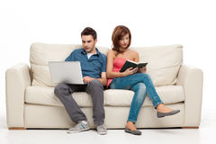 Couple sitting comfortably in couch Royalty Free Stock Photo