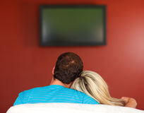 Couple sitting in a couch Royalty Free Stock Photography