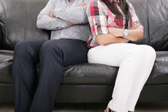Couple sitting of the couch having problems Royalty Free Stock Image