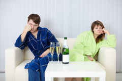 Couple sitting on couch after a quarrel Royalty Free Stock Image